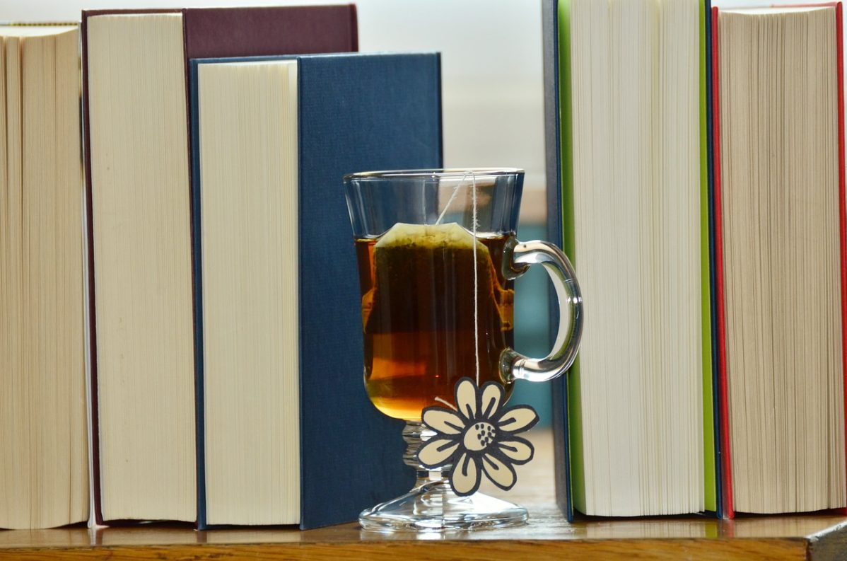 Cup of tea with surrounded by books