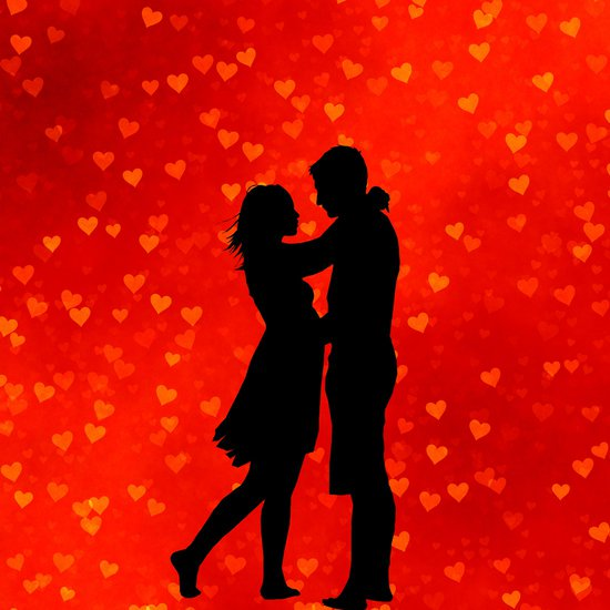 Couple silhouette on red heart background